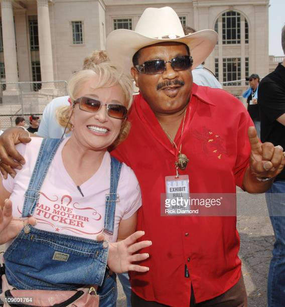 Tanya Tucker and Archie Bell during CMA Music Festival Michael Peterson/New Holland Celebrity Tractor Race at Sports Zone in Nashville Tennessee...