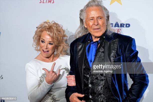 Tanya Tucker and Peter Nygard arrive for the Norby Walters' 27th Annual Night Of 100 Stars Black Tie Dinner Viewing Gala held at The Beverly Hilton...