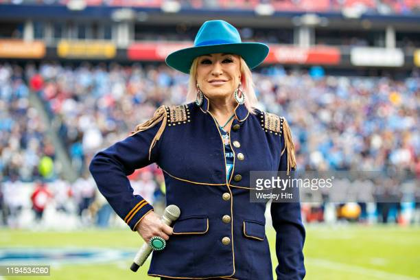 Tanya Tucker sings the National Anthem before a game between the Tennessee Titans and the Houston Texans at Nissan Stadium on December 15 2019 in...