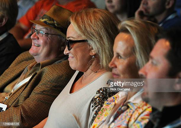 Tanya Tucker watches as Glen Campbell performs on SiriusXM's Elvis Radio and Outlaw Country channels in SiriusXM's Nashville studio on September 19...