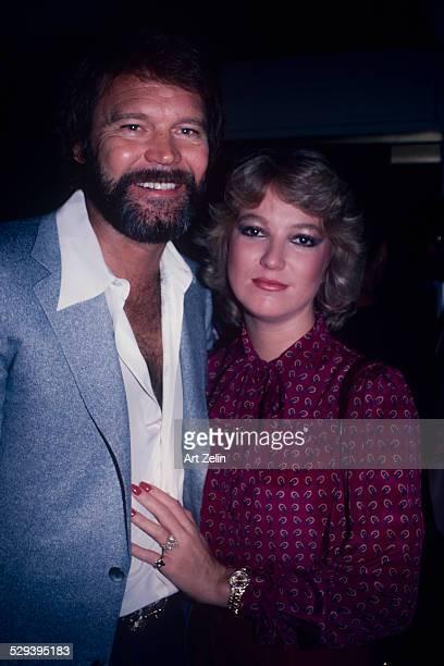 Tanya Tucker with Glenn Campbell She is wearing a fuchsia paisley blouse circa 1970 New York