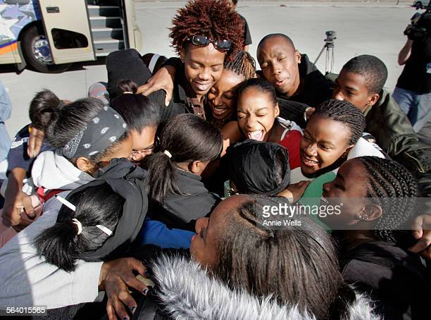 Tanya Walters, center cries as she and the students she took on a tour bus trip to Phoenix, Dallas, New Orleans and San Antonio over Christmas week...