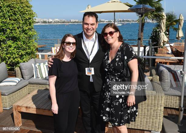Tanya Warren George Pimentel and Andrea Grau attend the TIFF OMDC cocktail event at the Cannes Film Festival on May 11 2018 in Cannes France