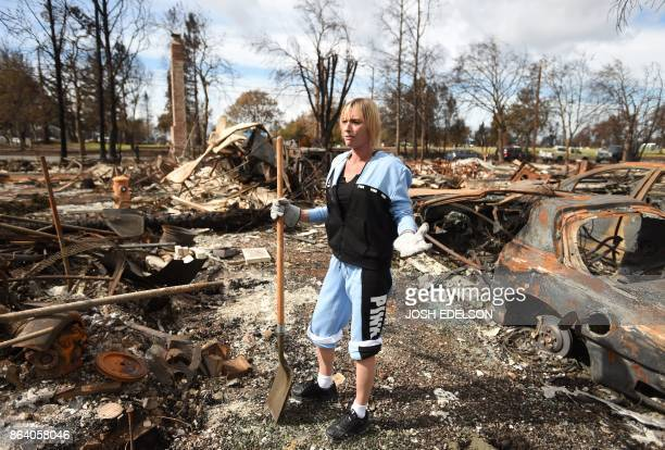 Tanya Williams reacts as she views her burned home in the Coffey Park area of Santa Rosa California on October 20 2017 Residents are being allowed to...