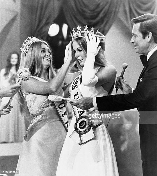 Tanya Wilson of Honolulu is crowned Miss USA of 1972 by Michele McDonald of Butler Pennsylvania Miss USA of 1971 at conclusion of annual pageant At...