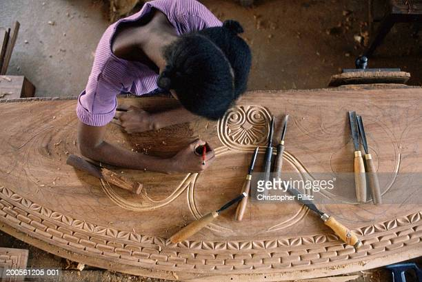 Tanzania, Dar es Salaam, Maconde wood carver at work, elevated view