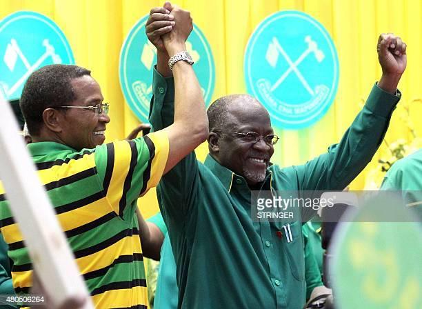 Tanzania President Jakaya Kikwete congratulates politician John Magufuli in Dodoma on July 12 after he was nominated ruling Chama Cha Mapinduzi...