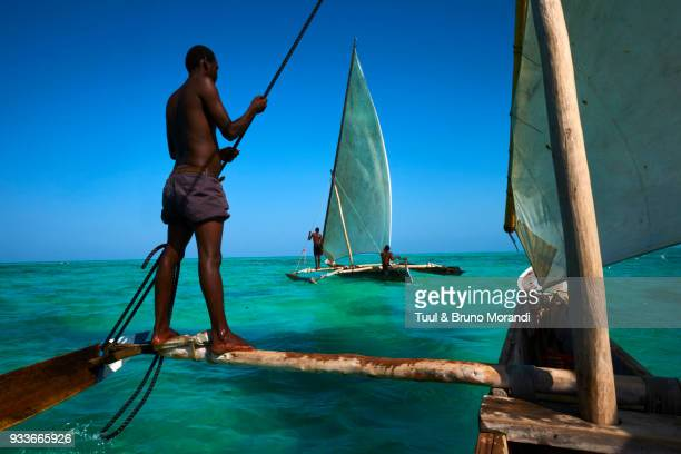 tanzania, zanzibar,  fisher on local boat at jambiani - zanzibar island stock photos and pictures