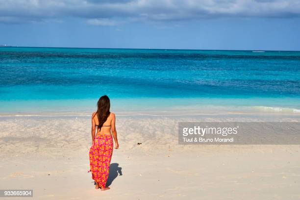 tanzania, zanzibar island, woman at nungwi beach - zanzibar island stock photos and pictures