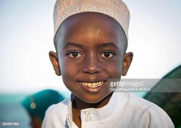 Tanzania Zanzibar Kizimkazi young muslim boy in school uniform on beach