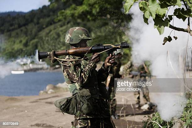 A Tanzanian African Union soldier shoots a rocket to the positions of supporters of renegade Anjouan leader Mohamed Bacar in Mutsamudu the capital...