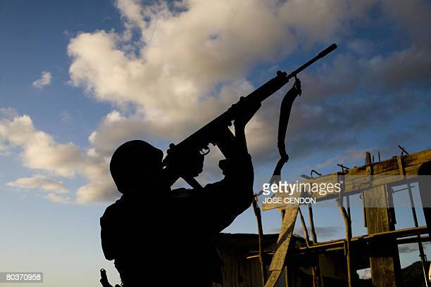 A Tanzanian African Union soldier shoots at the positions of supporters of renegade Anjouan leader Mohamed Bacar in Mutsamudu the Anjouan capital on...