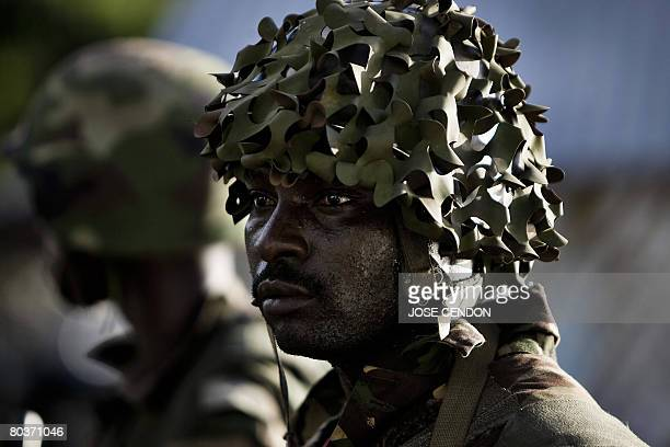 A Tanzanian African Union soldier stands on a street during clashes between supporters of renegade Anjouan leader Mohamed Bacar and a coalition of...