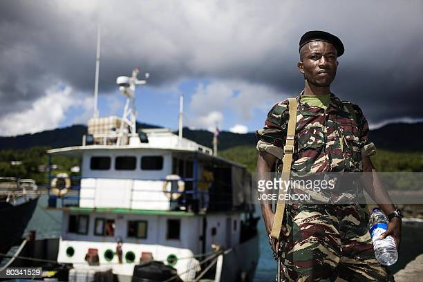 A Tanzanian African Union soldier waits to be transferred to a military camp after disembarking at the port of Fomboni the capital of Moheli on March...