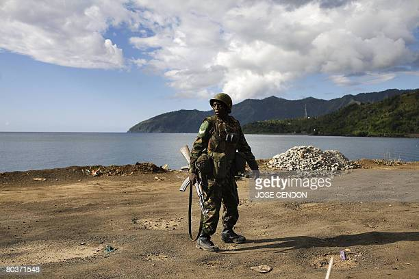 A Tanzanian African Union soldier walks near the beach searching for supporters of renegade Anjouan leader Mohamed Bacar in Mutsamudu the capital...