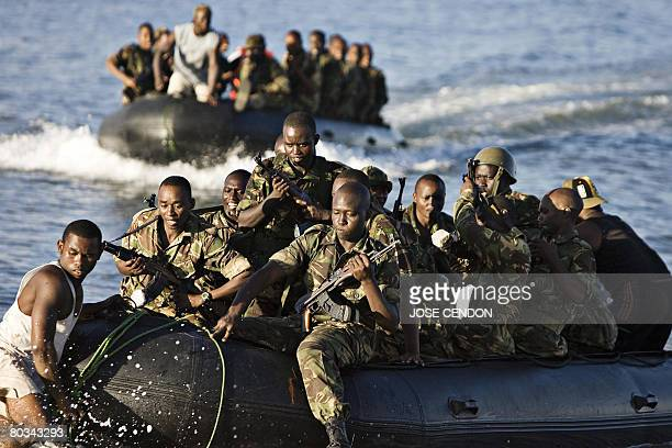 Tanzanian African Union troops arrive onto a beach during military training exercises in Fomboni the capital of Comoros island of Moheli on March 22...
