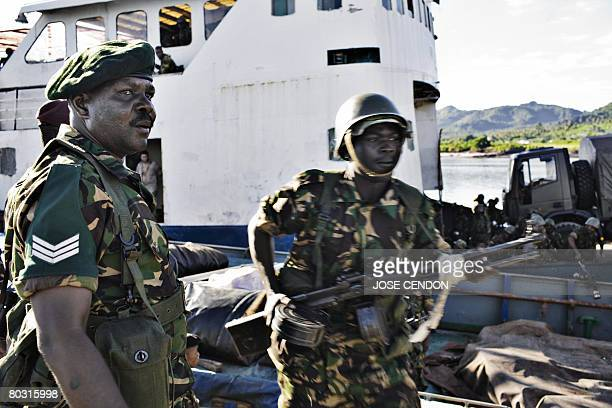 Tanzanian African Union troops disembark in the port of Fomboni the capital of Moheli on 20 March 2008 A first detachment of 300 Sudanese and...