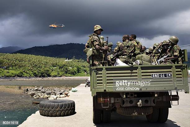 Tanzanian African Union troops wait to be transferred to a military camp after disembarking at the port of Fomboni the capital of Moheli on March 22...
