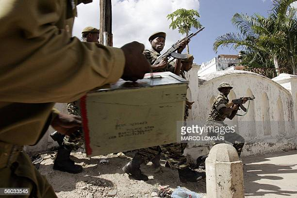 Tanzanian army pull in to take control of the Forodhani polling station 30 October 2005 in Stone Town Zanzibar Soldiers fired shots and teargas to...