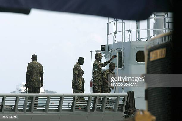 Tanzanian navy soldiers supervise the arrival of a cargo loaded with an APC in Stone Town Zanzibar 27 October 2005 A decade of rivalry between the...
