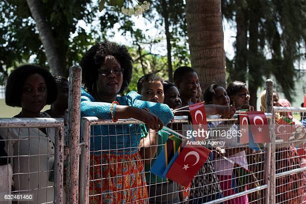 Tanzanian people hold Turkish and Tanzanian flag as Turkish President Recep Tayyip Erdogan is welcomed by Tanzanian President John Magufuli during an...