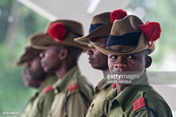Tanzanian police wait for delegates to arrive at the State House in Dar es Salaam on May 13 2015 for a crisis summit of East African leaders in...