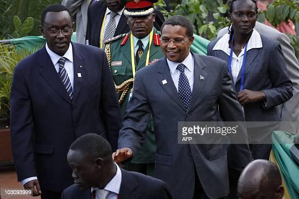 Tanzanian president Jakaya Mrisho Kikwete walks with the Rwandan Prime Minister Bernard Makuza during the second day of the 15th African Union Summit...