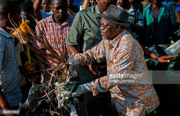 Tanzanian President John Magufuli joins a cleanup event outside the State House in Dar es Salaam on December 9 2015 Magufuli cancelled Independence...