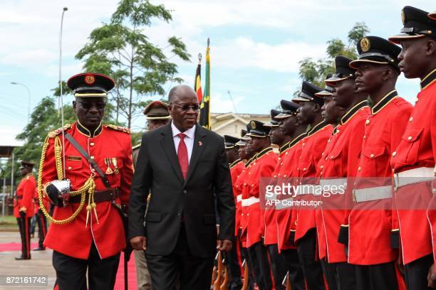 Tanzanian President John Magufuli reviews a military honour guard before attending the launching ceremony of a onestop border post to speed up slow...