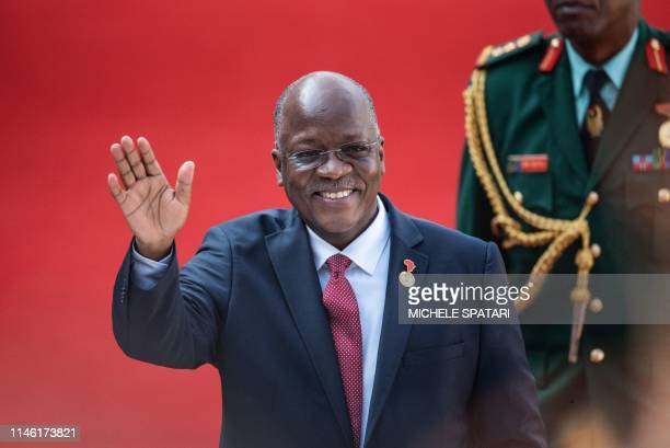 Tanzanian President John Pombe Magufuli gestures while arriving at the Loftus Versfeld Stadium in Pretoria South Africa for the inauguration of...