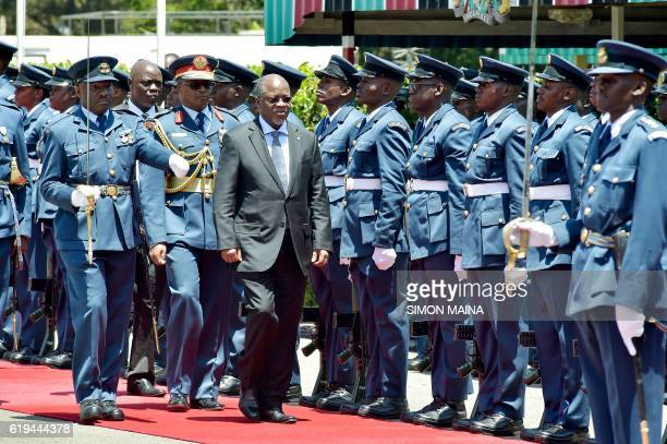 Tanzanian President John Pombe Magufuli reviews the troops upon his arrival at the State House in Nairobi on October 31 2016 President Magufuli is in...