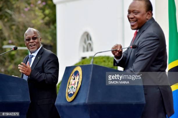 Tanzanian President John Pombe Magufuli speaks as his Kenyan counterpart Uhuru Kenyatta listens during a joint press conference on October 31 2016 at...