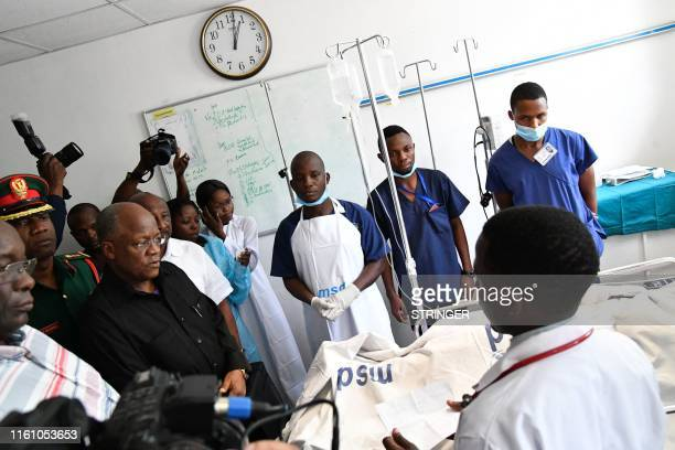 Tanzanian President John Pombe Magufuli talks to medical staff and victims of the Morogoro petrol tanker explosion at the Muhimbili National Hospital...