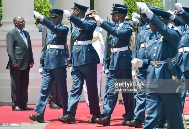 Tanzanian President John Pombe Magufuli watches the military parade upon his arrival at the State House in Nairobi on October 31 2016 President...