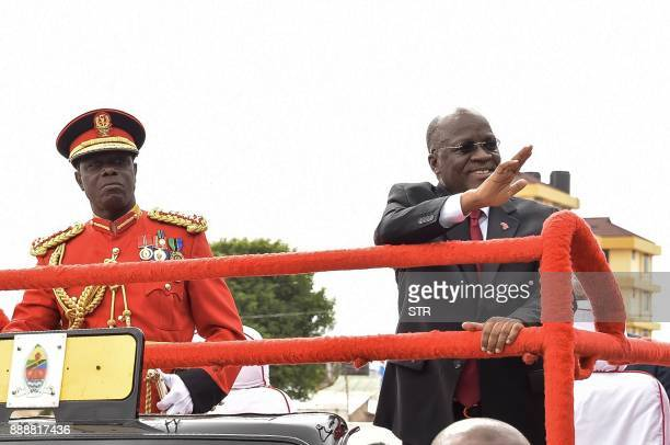 Tanzanian President John Pombe Magufuli waves as he attends a ceremony marking the country's 56th independence anniversary in Dodoma on December 9...
