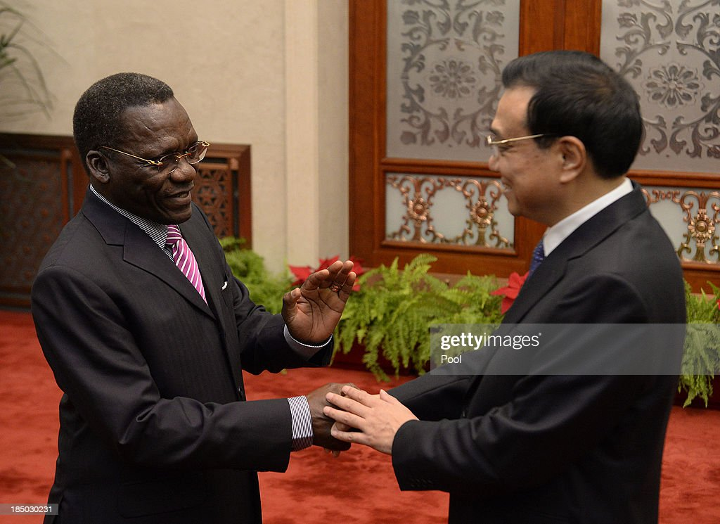 Tanzanian Prime Minister Mizengo Pinda (L) shakes hands with Chinese Premier Li Keqiang before a meeting at the Great Hall of the People on October 17, 2013 in Beijing, China. The two leaders met to discuss China-Tanzania relations.