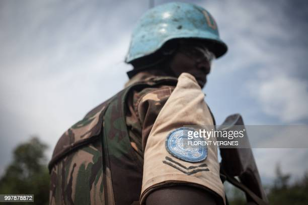 Tanzanian soldier from the UN peacekeeping mission in the Central African Republic , patrols the town of Gamboula, threatened by the Siriri group, on...