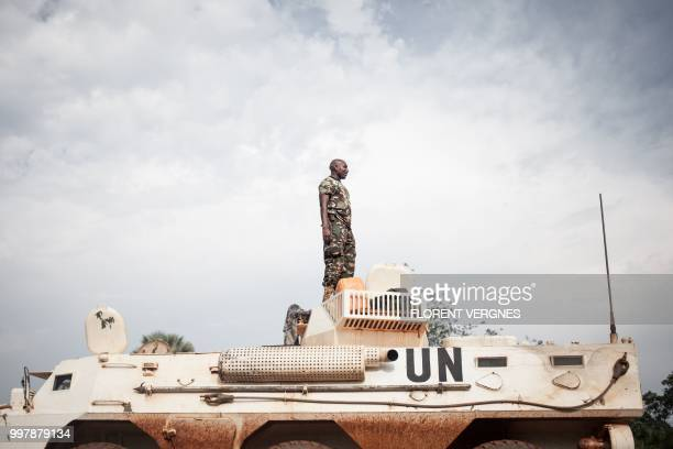 A Tanzanian soldier from the UN peacekeeping mission in the Central African Republic patrols the town of Gamboula threatened by the Siriri group on...