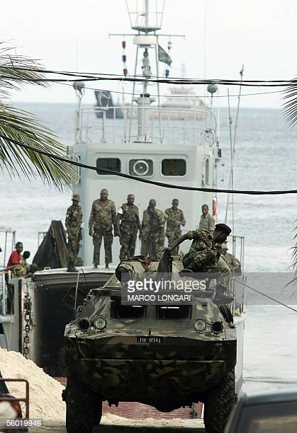Tanzanian soldier jumps from an APC upon arrival in Stone Town Zanzibar 27 October 2005 on a military cargo A decade of rivalry between the ruling...