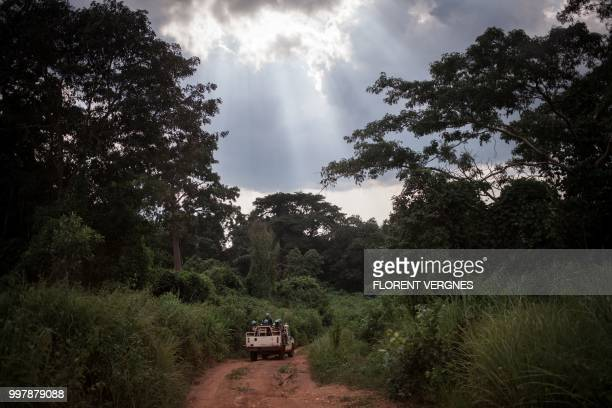 Tanzanian soldiers from the UN peacekeeping mission in the Central African Republic patrol the town of Gamboula threatened by the Siriri group on...