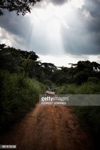 Tanzanian soldiers from the UN peacekeeping mission in the Central African Republic patrol on the way to Amada Gaza a town attacked by the Siriri...