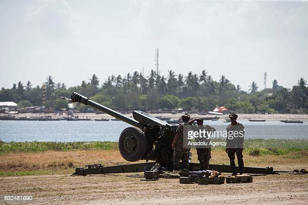 Tanzanian soldiers make preparations before the welcome ceremony for Turkish President Recep Tayyip Erdogan ahead of a meeting with Tanzanian...