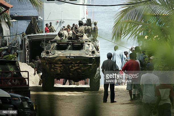 Tanzanian soldiers supervise the arrival of an APC from a military cargo in Stone Town Zanzibar 27 October 2005 A decade of rivalry between the...