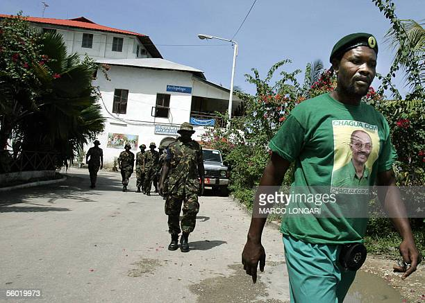 Tanzanian soldiers walk on a waterfront following a ruling Chama Cha Mapinduzi supporter in Stone Town Zanzibar 27 October 2005 A decade of rivalry...