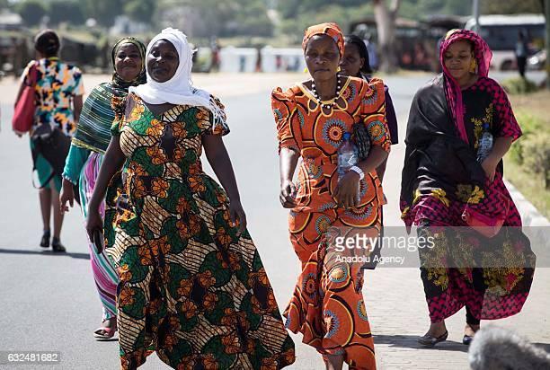 Tanzanian women arrive to welcome Turkish President Recep Tayyip Erdogan ahead of his meeting with Tanzanian President John Pombe Joseph Magufuli in...