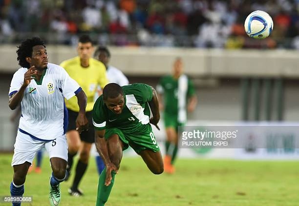 Tanzania's midfielder Andrew Chikupe vies with Nigeria's forward Odion Ighalo during the 2017 African Cup of Nations qualification football match...
