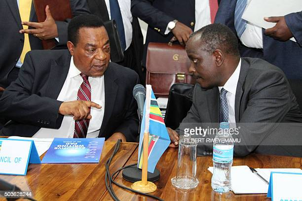 Tanzania's Minister of Foreign Affairs Augustine Mahiga and the Secretary General of the East African Community Richard Sezibera speak during a...