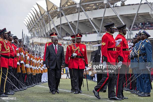 Tanzania's newly elected president John Magufuli reviews troops during the swearing in ceremony in Dar es Salaam on November 5 2015 John Magufuli won...