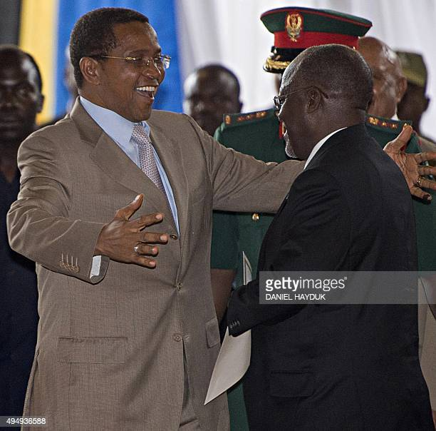 Tanzania's outgoing President Jakaya Kikwete embraces Presidentelect John Magufuli during an official ceremony to announce Magufuli's victory after...