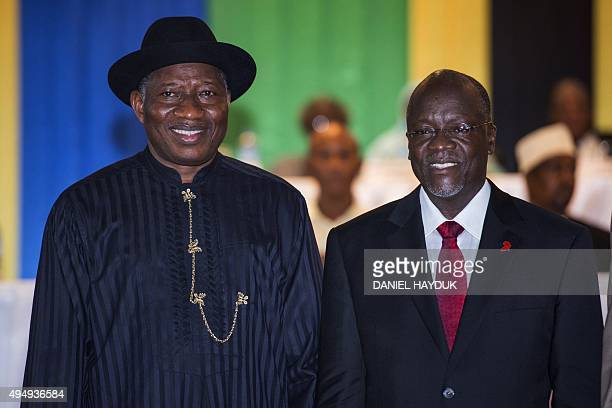 Tanzania's Presidentelect John Magufuli poses with former president of Nigeria Goodluck Jonathan during an official ceremony to announce Magufuli's...